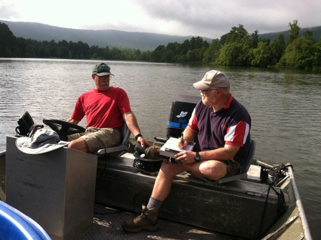 Herman Scoggins and Noel Holcomb of Coosa Valley TU prepare data from lake  survey on Lake Marvin.